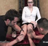 Two slaves worship Domme's sexy feet