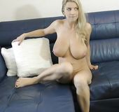 Busty MILF plays with her sex toy delivery